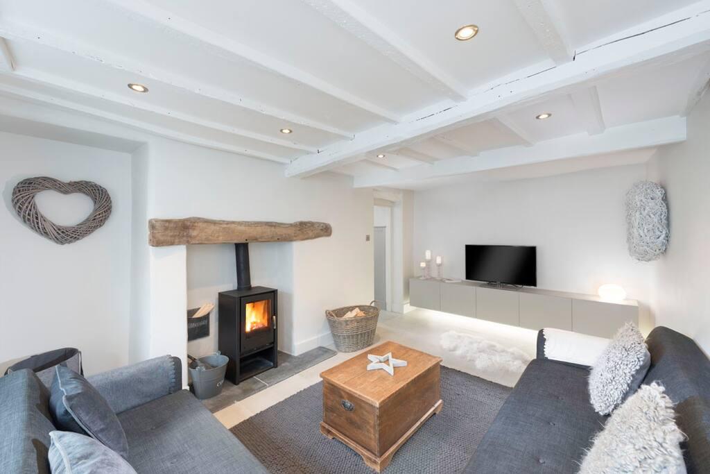 Cosy lounge with multi-fuel log burner & smart TV