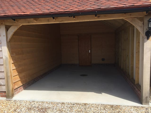 Full use of covered parking area.  With entrance door to the accommodation.
