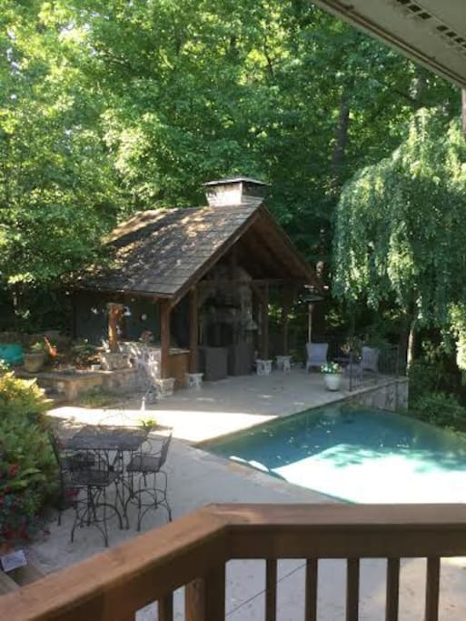 Pool cabana with bathroom, outdoor shower, wetbar and fireplace