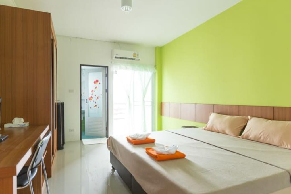 The apartment has a queen bed, air conditioner and private bathroom and fridge for your use.
