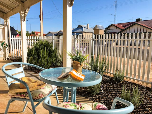 Relax with a book on the verandah of Inglenook cottage, Moonta