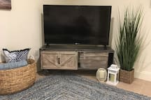 50 inch smart tv (with basic cable), that is ready for you to log in to your Hulu, HBO Go, Amazon Prime, and Netflix account.