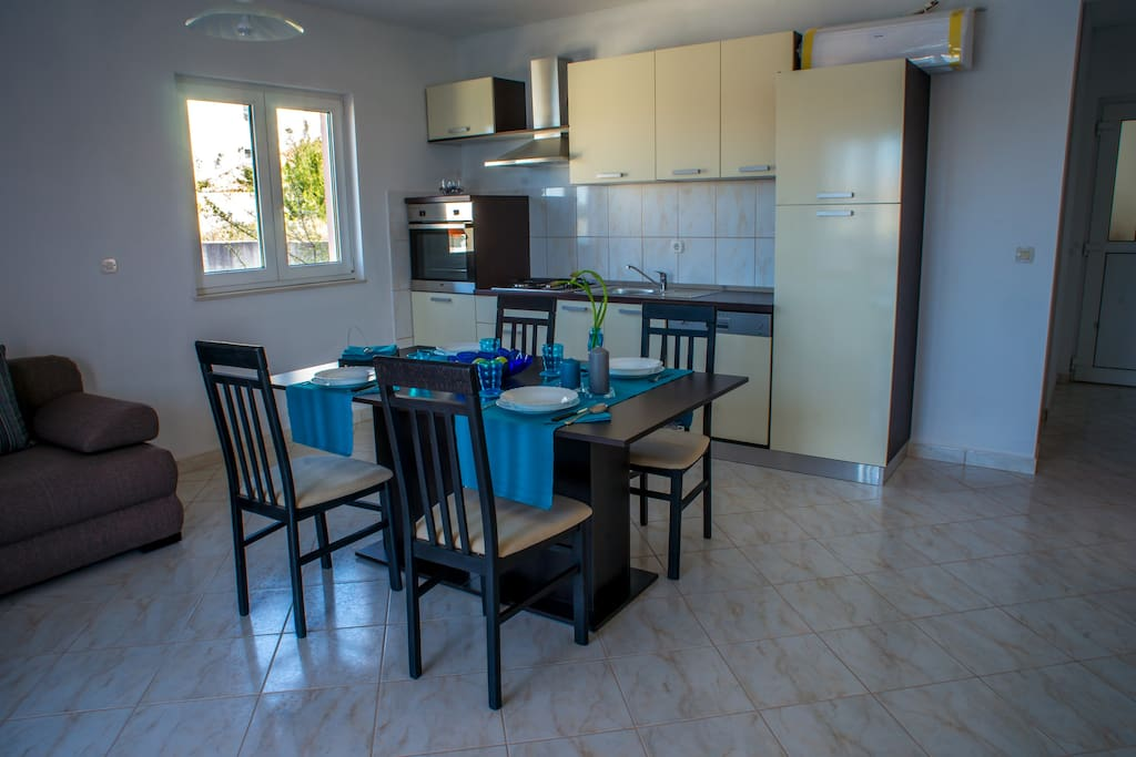 A spacious kitchen, dining area and living room