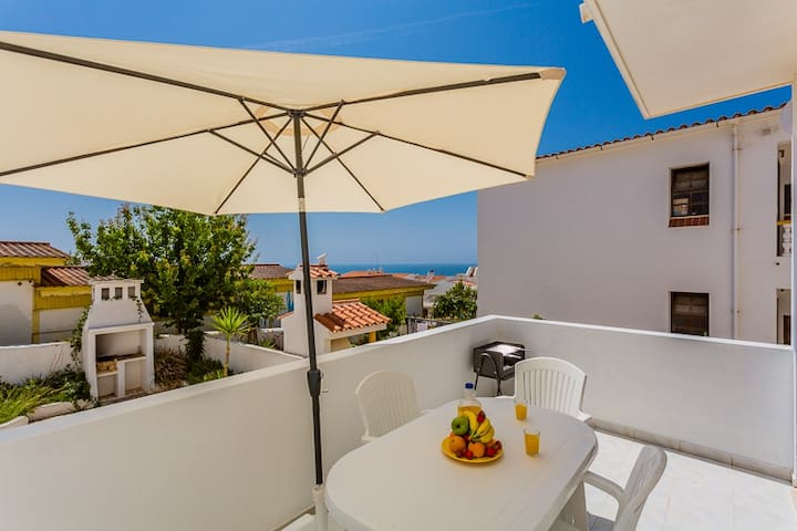 The private balcony has a table with 4 chairs, a portable barbecue and a sun umbrella for those hot days.