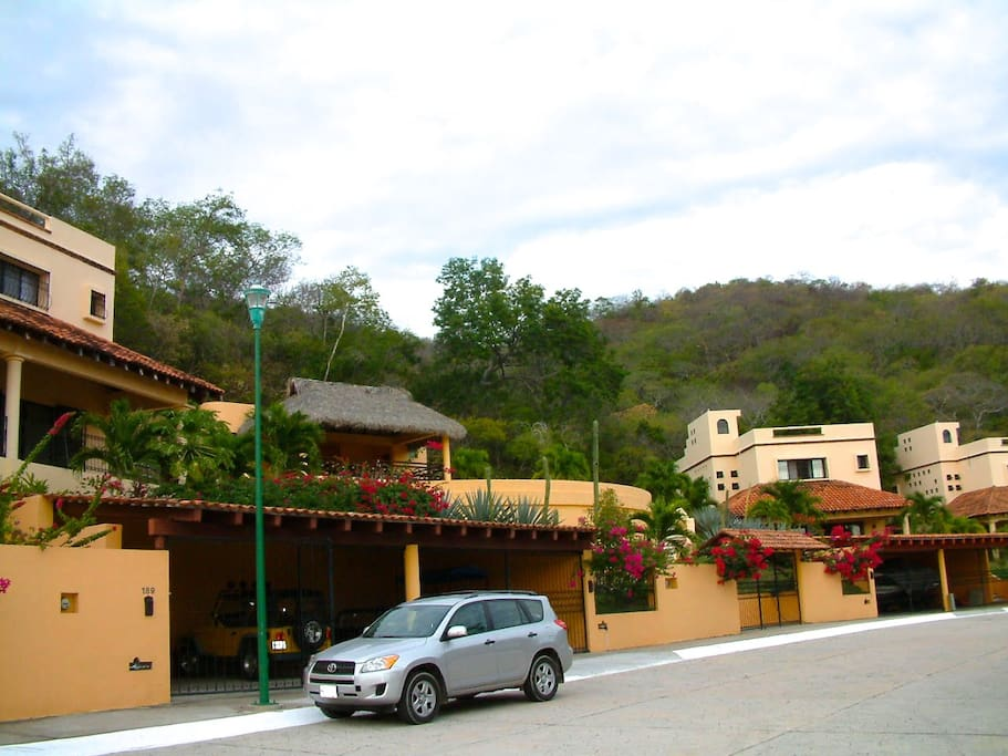 view of villa complex and parking area
