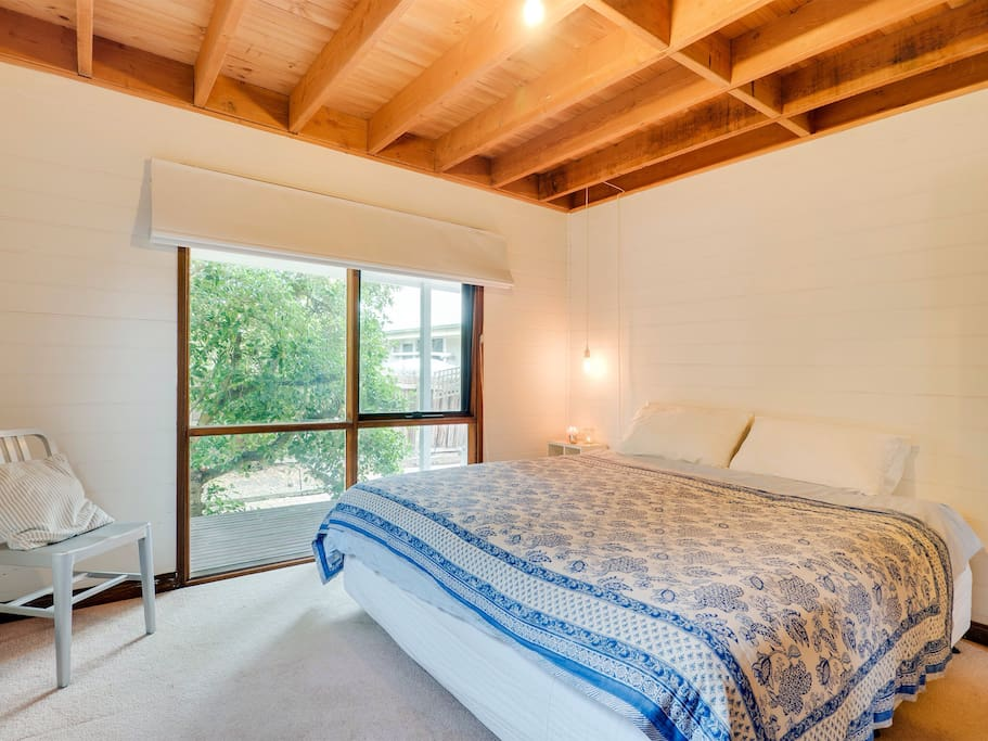 The main bedroom features a King Size bed and a roomy walk-in wardrobe.