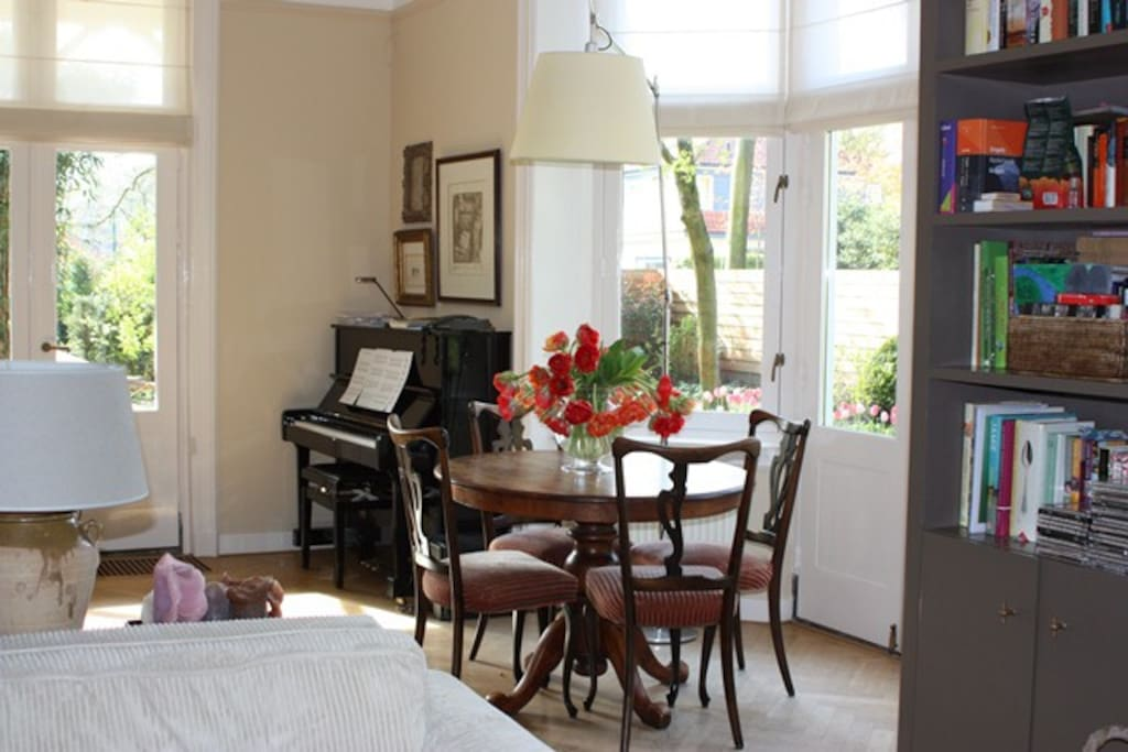 Our living room is spacious and sunny with a view on the garden.
