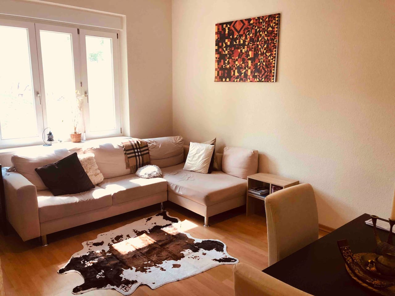 Living room with a foldable designer sofa bed that sleeps 2 people comfortably