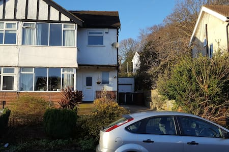 Private double bedroom with en suite bathroom. - Horsforth