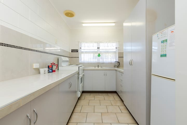 The kitchen is fully equipped with everything you could possibly need for a family getaway.    There is even a second fridge in the laundry should you need more room!    If cooking is not your thing, there are 3 dining out/takeaway options.