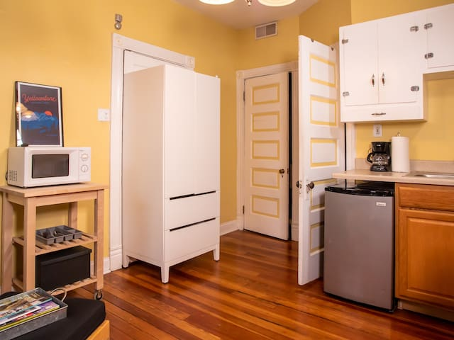 Kitchen has a microwave, toaster oven and fridge.