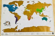 Our scratch-off wall map under the coffee table top. Maybe someday we'll make it to Russia...