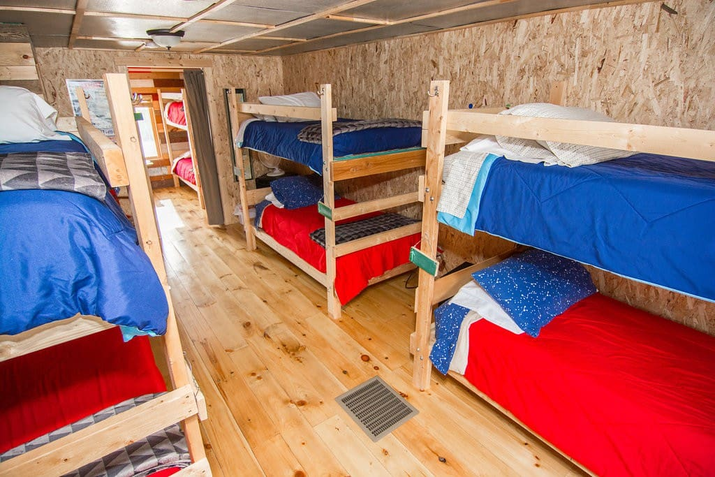 The main bunkroom in the bunkhouse loft sleeps up to 6 guests with 3 sets of bunks.