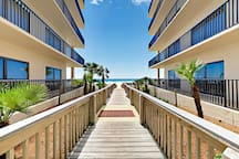 Direct access to white sand beaches from the Palms.