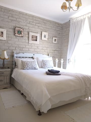 Comfortable queen bed in room with ample space. ( 2nd bedroom)
