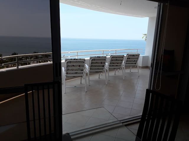 Another view looking out from the sala to the main balcony.