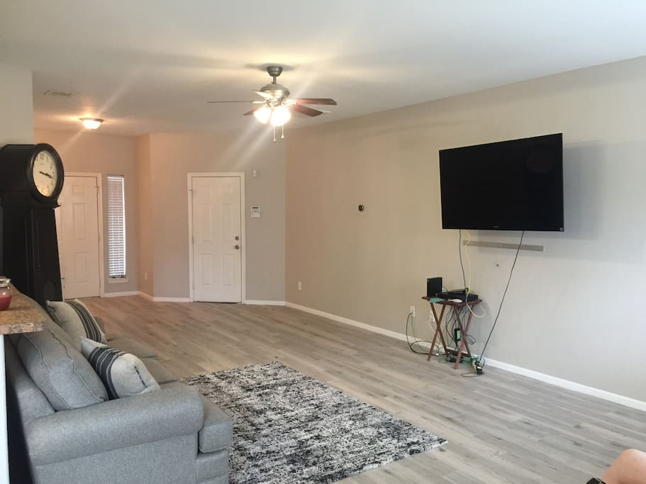 Picture of living room with a fresh coat of paint applied in Dec.2016, prior to adding entertainment system hooks up to the wall.