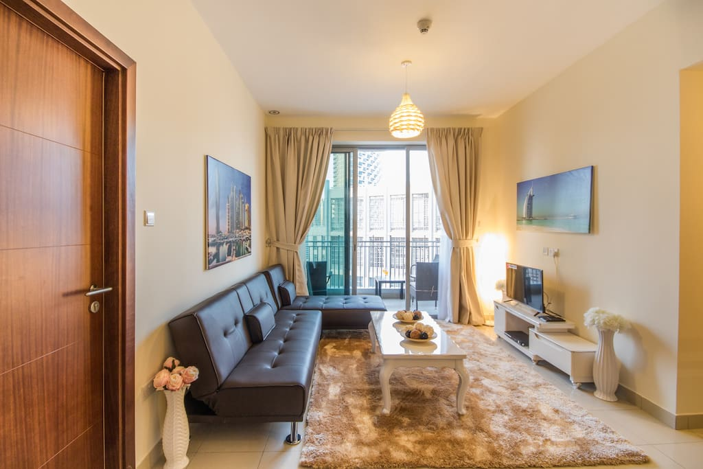 Welcome to Dubai: This living room features a balcony with Burk Khalifa view, a large TV and a comfortable sleep sofa (sleeps 2).