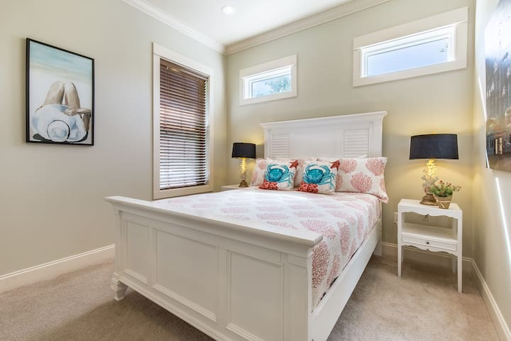 Cozy first floor guest room with queen bed. All bedroom TVs are also equipped with Roku streaming sticks so you can enjoy your favorite Netflix, Amazon Video, Disney+ and Hulu shows and movies from the comfort of your own room!