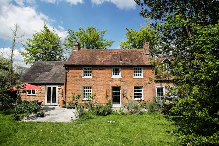 A grand country cottage with stunning gardens