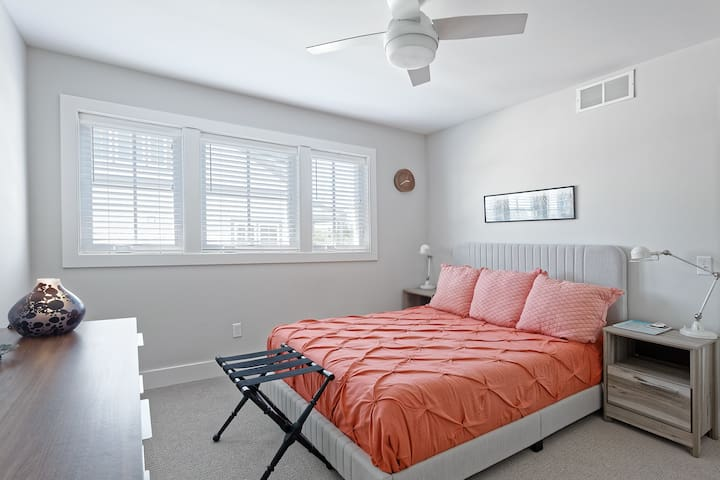 Bedroom 2 - upstairs. Equipped with queen size bed, closet, and dresser.