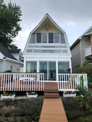 Spacious lake front deck with fireplace, grill, and plenty of seating