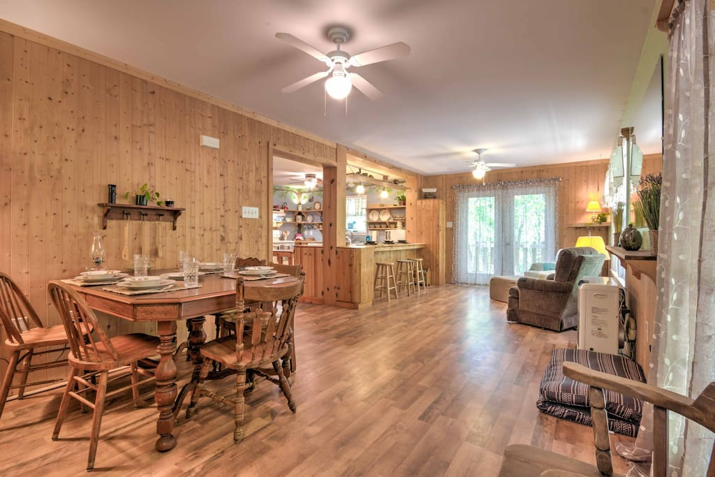 Wood floors, wood walls and wood furniture carry on a rustic ambiance throughout the home.