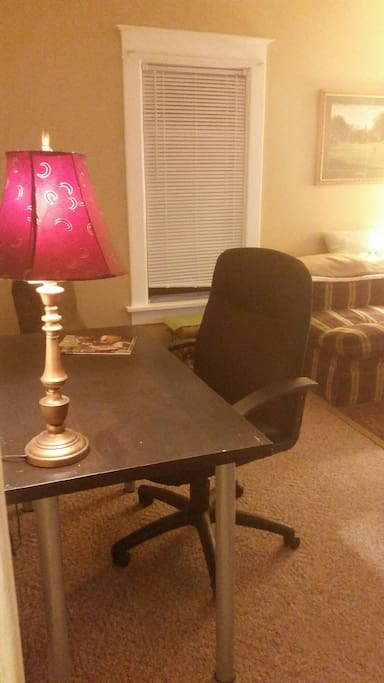 Work space with rolling office chair in living room. Internet and Netflix provided for you.