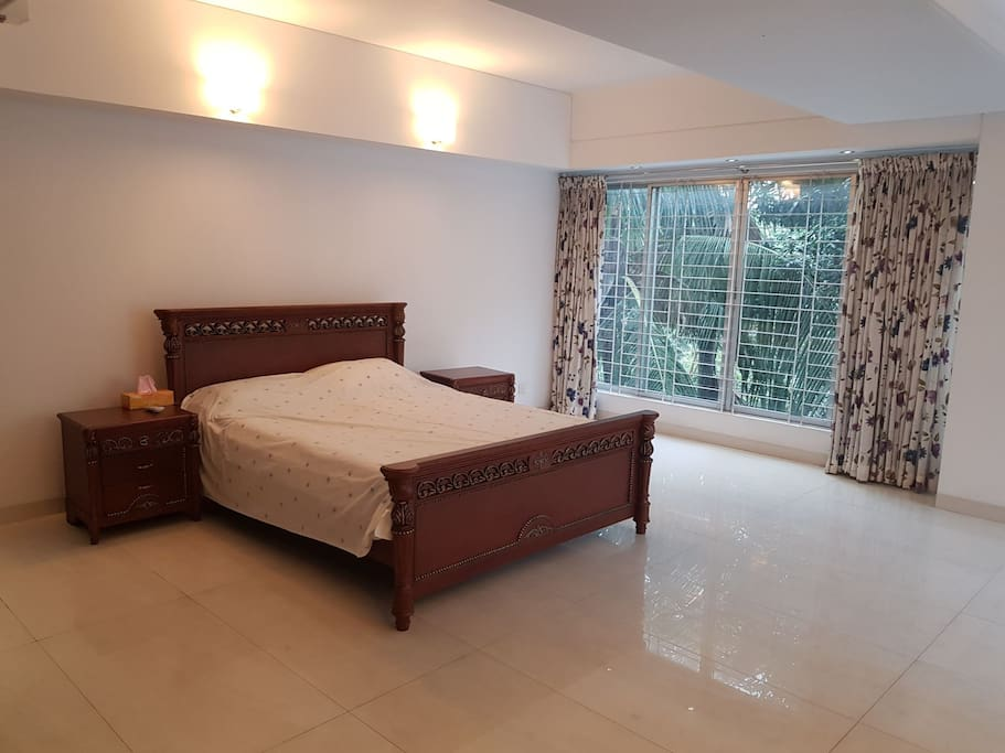 suite bed room,king size bed with big green view window,proper sunlight.