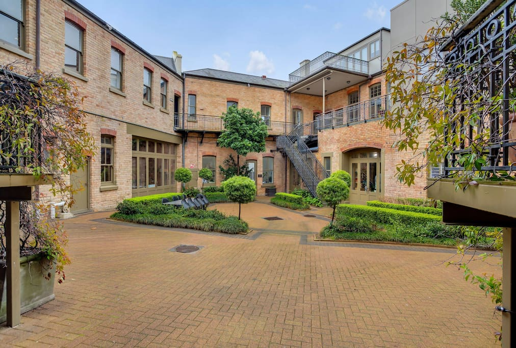 The courtyard of the apartment building is a peaceful sanctuary in the heart of the city