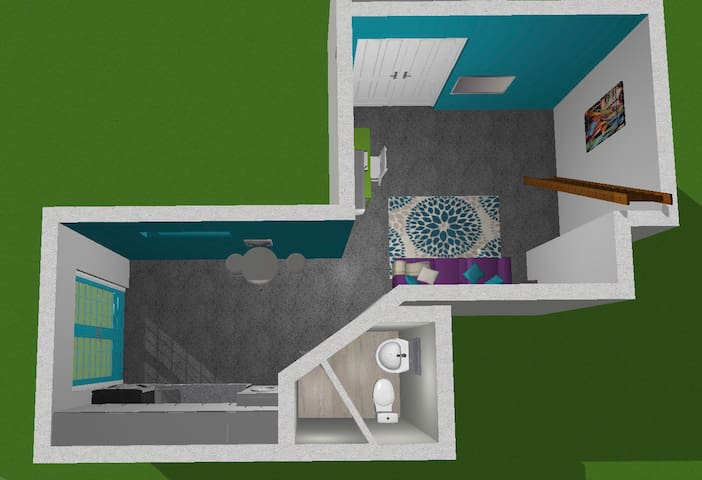 This 3d Model shows the view of the kitchen and bathroom.  The bathroom is small but very functional.