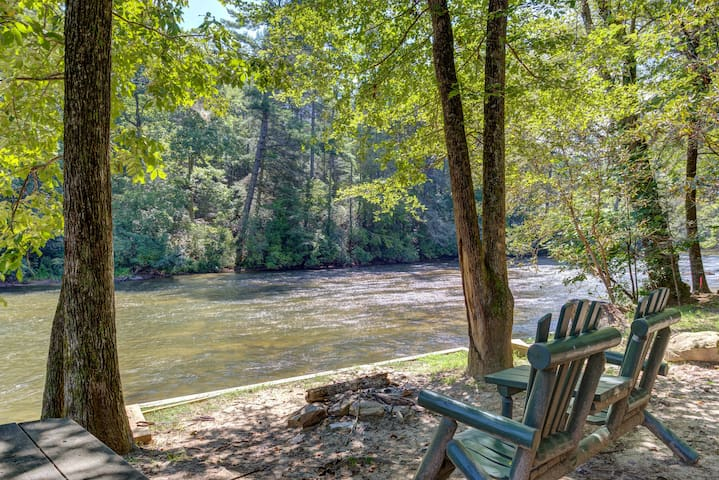 Fish & raft at this riverfront home w/ hot tub, firepit & large screened porch!