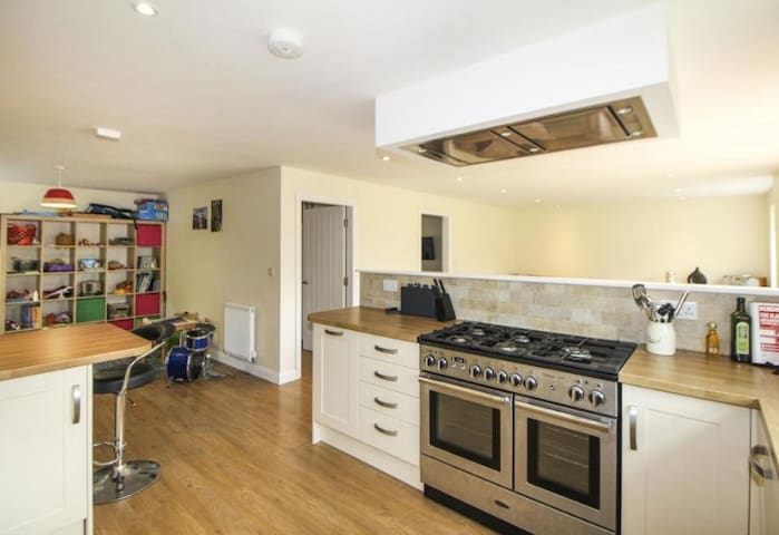 Kitchen - Includes double cooker, microwave, integral dishwasher, fridge and freezer.