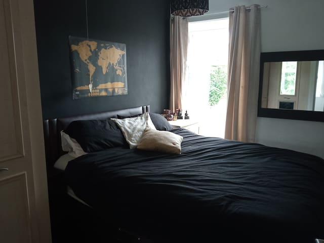 Master bedroom with king size bed and fitted wardrobes and drawers