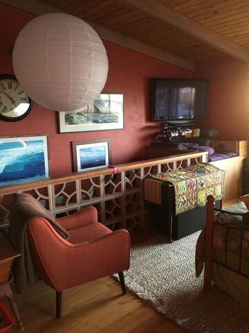 Cozy living area with a day bed and trundle to accomodate 2 additional adults in real beds.  TV has streaming Netflix and Amazon Prime.