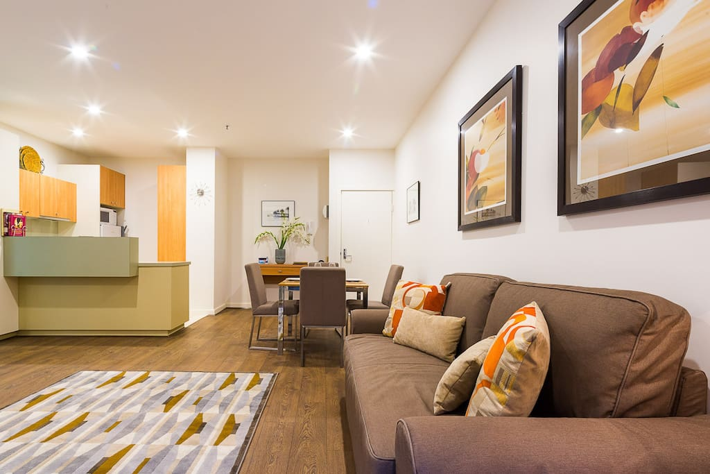 Living and dining area for 4 people & kitchen in this 1-bedroom StayCentral St Kilda Serviced Apartment