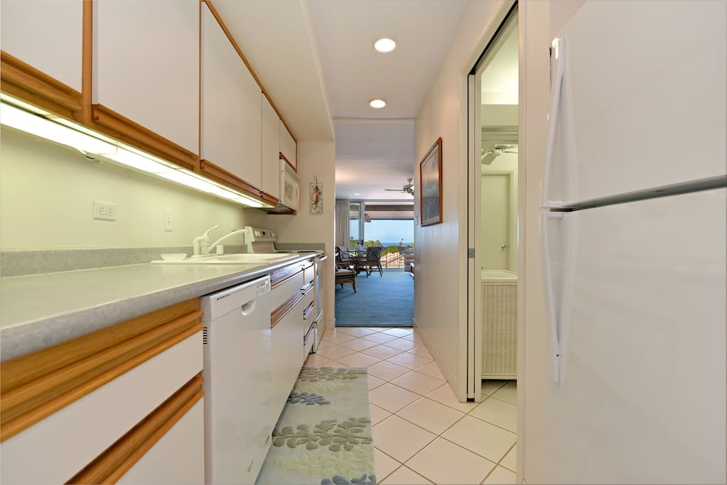 Enjoy a meal in with a full kitchen - Stove, Microwave, Fridge/Freezer, Dishwasher.   Washer Dryer in unit as well.