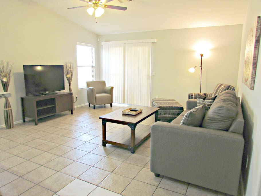 """Living room with 50"""" HDTV and queen size sofa sleeper w/ memory foam mattresss"""