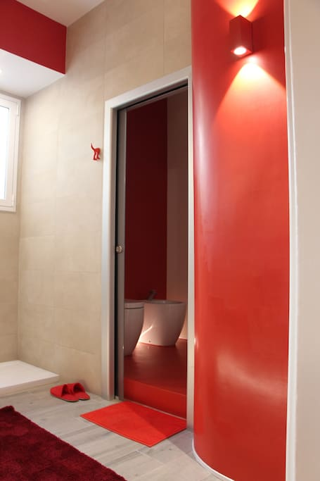 entrance space to the red bathroom