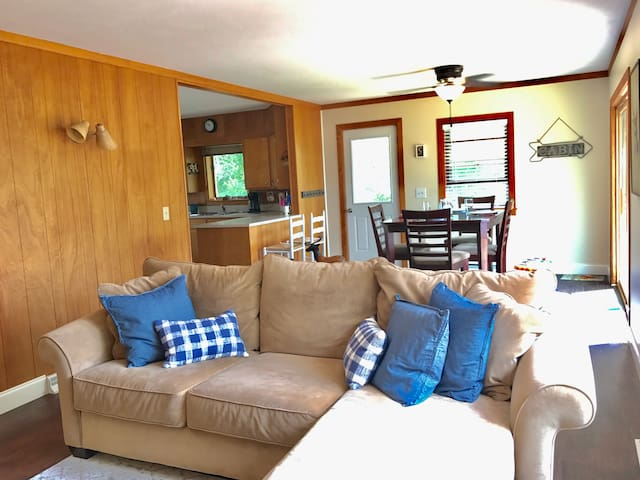 Upstairs living space, open to kitchen and large deck
