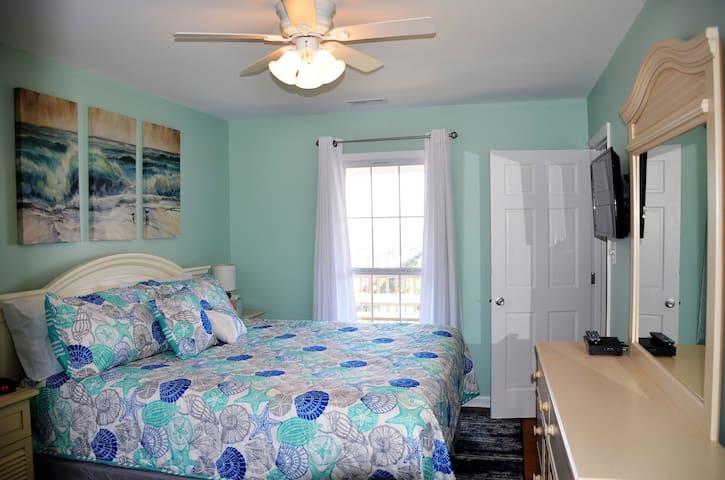 Main floor master bedroom, king bed and ocean view