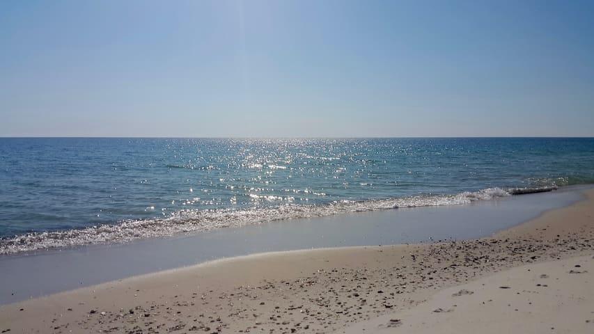 Just a short walk to a Beautiful White Sand Beach