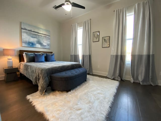 Master bedroom with queen bed, closet & blackout curtains! Private connecting bathroom.