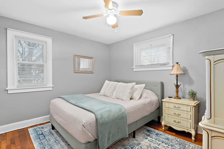 Memory foam queen-sized bed sleeps 2 easily and includes beautiful French provincial antique dresser and end table.