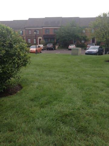 condo's around a footballfield-                            size lawn