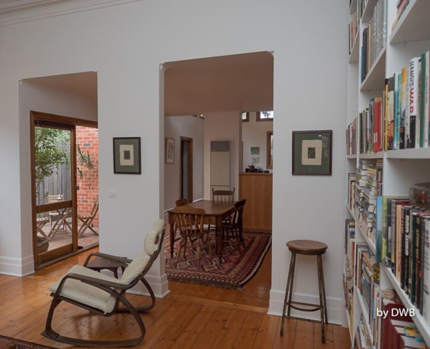 Spacious living room and dining room, looking out on to one of the two courtyards.