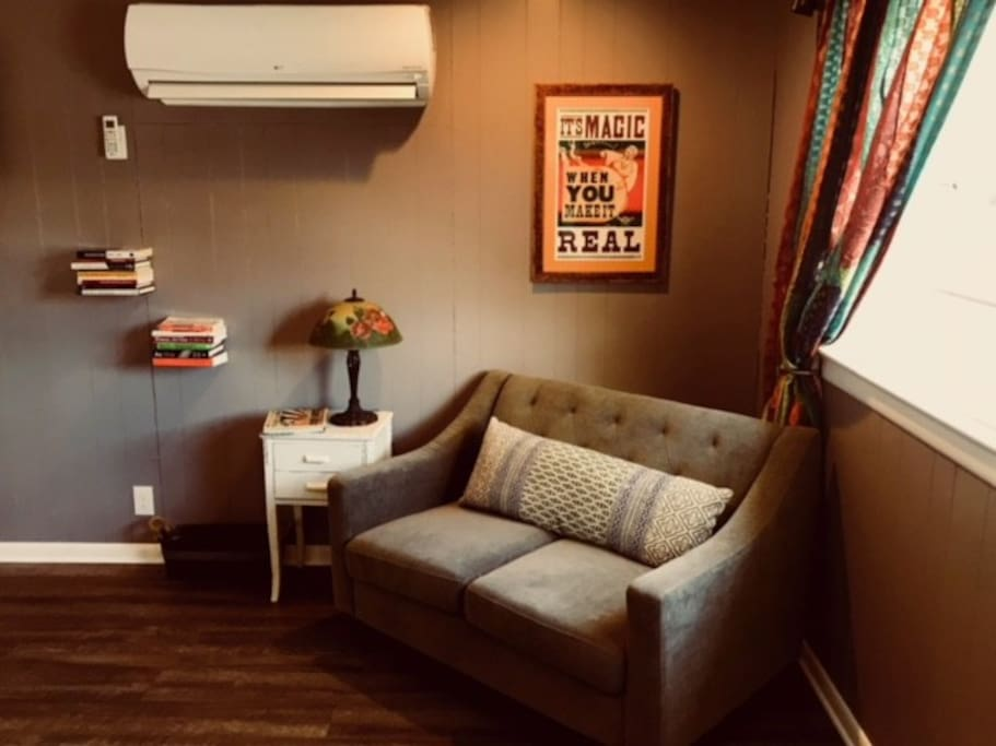 Comfortable lounge area perfect for reading or surfing the web.