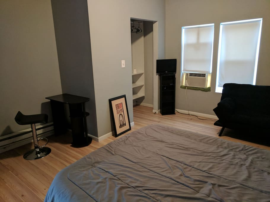 Television, Desk and Closet space.