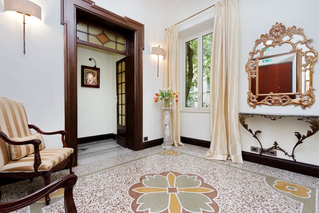 "The apartment's gracious entry foyer welcomes you to this spacious, luxury apartment. To the right are the ""public rooms"": living room, dining room and kitchen. Beautiful original polished terrazzo floors."