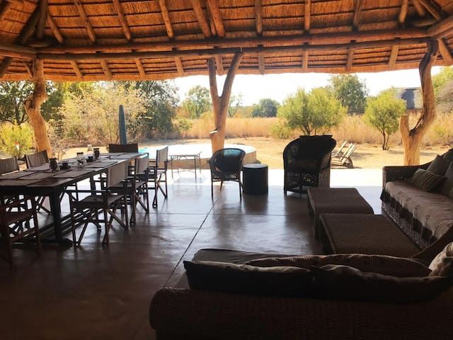 The big, open verandah with lots of space for bush meals and naps on the day beds..
